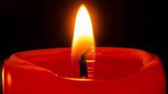 Romantic Christmas Candle Light (fstop186) Tags: christmascandle red romantic glow flame hotwax christmas candle orange blue macro bokeh wax romance love wick fire heat flickering warmglow smilefromtheheart romanticmeal meltingwax molten soft reflection olympusem1 olympused60mmf28macro