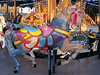 By A Length. (vic.devo) Tags: carousel stallion colorful lights circus midway olympusomdem10markii rokinon75mm