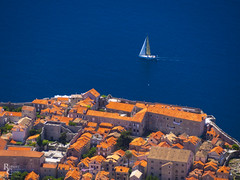 Red Tiles, Blue Sea (RobertCross1 (off and on)) Tags: 40150mmf456mzuiko adriatic croatia dalmatia dubrovnik em5 europe hrv hrvatska omd olympus architecture boat buildings city cityscape landscape medieval roof sailboat sea seascape ship tiles water