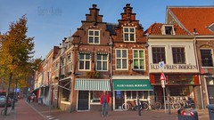 Jacobijnenstraat, Haarlem, Netherlands - 5636 (HereIsTom) Tags: webshots travel europe netherlands holland dutch view nederland views you sony cybershot hx9v nature sun tourists cycle vakantie fietsvakantie cycling holiday bike bicycle fietsen street sky people jacobijnenstraat boekhandel bakkerij brick city en brood 2017 stepped fabriek blue town shops huizen gables meel buildings houses september trapgevels history haarlem 1662 monument