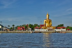 Golden Buddha statue by the Chao Phraya river opposite Koh Kret (UweBKK (α 77 on )) Tags: buddha buddhist buddhism religion religious statue gold blue red evening light chao phraya river koh kret bangkok thailand southeast asia sony alpha 77 slt dslr