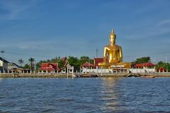 Golden Buddha statue by the Chao Phraya river opposite Koh Kret (UweBKK (α 77 on )) Tags: buddha buddhist buddhism religion religious statue gold blue red evening light chao phraya river koh kret bangkok thailand southeast asia sony alpha 77 slt dslr