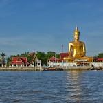 Golden Buddha statue by the Chao Phraya river opposite Koh Kret thumbnail
