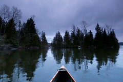 In the lee of the pines... (deanspic) Tags: lakelouisa quebec bow pines canoe canoeing vfmc g3x hybrid