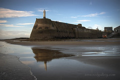 PORTHCAWL LIGHTHOUSE REFLECTIONS, WALES. (IMAGES OF WALES.... (TIMWOOD)) Tags: porthcawl south wales bridgend lighthouse pier rnli lifeboat lifeboatmen exercise coast seascape reflections in memory tim wood gallery landscape photo photograph welsh flickr