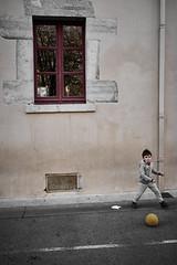 An old school : the yellow ball #3 (richardtostain) Tags: école school rue street scene jeu ballon enfant candid pentax limited 31mm