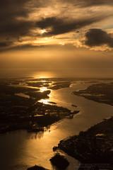 Sunset on the Fraser River (Lee Rosenbaum) Tags: sun landscape sunset airplane water fraserriver britishcolumbia windowseat aerialphotography clouds richmond canada ca