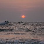 Sun sets at the Baga beach in Goa, India thumbnail