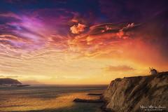 Aixerrota on fire (Mimadeo) Tags: storm stormy clouds coast dramatic sky sunset evening sea getxo basquecountry paisvasco euskadi vizcaya bizkaia spain shoreline shore rocks landscape clilff mill silhouette aixerrota