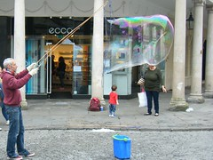 A BIG bubble🎈🎈🎈🎈🎈Lovely picture !!! (rossendale2016) Tags: froth suds rocks photograph photo this thisphotorocks microscopic micro like thinly thin gossamer magnification magnified elasticity elastic bucket container retail shop doorway door small watching impressive child longcane window reflection glazing glass light bubbly wind air 🎈🎈🎈🎈🎈 liquid fairy detergent soapy practices plenty practice hard blowing windy wet unusual imaginative art streetart ancient old south baths bath outside centre city road street water picturesque photogenic iconic clever wonderful red blue soap bubble massive large big