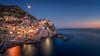 Italy - moon over Manarola (Toon E) Tags: 2017 italy laspezia cinqueterre italianriviera monterossoalmare vernazza corniglia manarola riomaggiore sunset bluehour reflection water sea mediterranean moon moonlight sony 7rm2 zeiss sonyfe1635mmf4