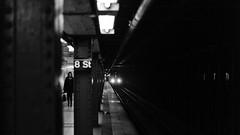 Pole position (Dj Poe) Tags: leica leicammonochrom andrewmohrer djpoe 2017 bw blackandwhite blancoynegro city nyc ny newyorkcity monochrome zeiss carlzeisslenses planart250 zm availablelight street streets candid zeisscameralenses subway mta train trains underground women lady