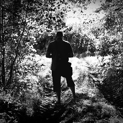 Only the woods bear darkness ..... (Missy Jussy) Tags: man trevorkerr woodland wood forest countryside darkness dappledlight sunlight morning france frame trees shadows mono monochrome blackwhite bw blackandwhite canon canon5dmarkll 50mm ef50mmf18ll ef50mm canon50mm fantastic50mm
