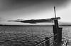 Sirmione (MaxDeVa) Tags: 28mm cielo pontile ricoh lago bw sky blackandwhite lake sirmione garda grii