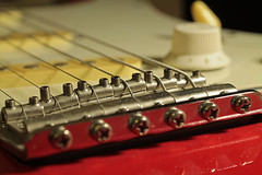 The bridge, strung for a left-hander (christina.marsh25) Tags: fenderstratocaster fender stratocaster guitar electricguitar bridge strings volumecontrol knob macromondays memberschoicemusicalinstruments