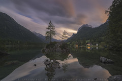 Harmony (ludwigriml) Tags: aftersunset bavaria beach berchtesgaden calmness europe evening eveningglow flags forest green hintersee hotel lights mountainglow ramsau rock seaside serenity shore snow still sunset warterfront water waterside germany harmony lake mountains nature outdoors trees ramsaubeiberchtesgaden bayern de
