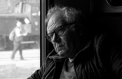 Days of smoke and steam. (Neil. Moralee) Tags: neilmoraleenikond7200 neilmoralee man face portrait window candid train rail steam old mature gricer spotter glasses sleepy tired wrinkles wrinkled black white mono monochrome bw bandw blackandwhite station platform glass neil moralee nikon d7200 bishops lydeard gwr br