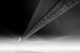 fine art black & white perspective of Pont du Normandie arching across a misty Seine River, near Honfleur, Normandy, France