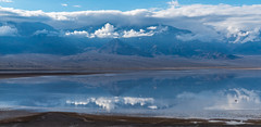 Dwarfed (Kurt Lawson) Tags: california clouds copyrighted crowd death deathvalley lake manly mountains national panamint park people pyramid reflection sky valley water