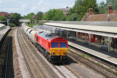 Newbury, UK     2017 by keithwilde152 - The evergreen Newbury station sees DB Schenker's loco 66044 pass through upon 10.37 Whatley Quarry-Churchyard Sidings Tarmac quarried aggregates. Pending route electrification will require the vantage footbridge to be removed and replaced by another structure on an alternative site.  1st June 2017