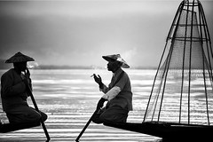 The ancient art of conversation~ Myanmar (~mimo~) Tags: photography street portrait canon people net fishing cigarette smoke inle lake boat fishermen morning sunrise travel asia burma myanmar