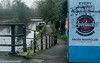 Clubbing Or Walking? (M C Smith) Tags: lea canal boats narrowboats pentax k3 poster letters ramp railings water blue red green grass sign signs bin pavement bridge graffiti black symbols numbers river riverlea puddles path footpath canalpath orange slope