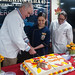 SECNAV Richard V. Spencer cuts a cake with Culinary Specialist Seaman Apprentice Daisy Magana aboard USS America.