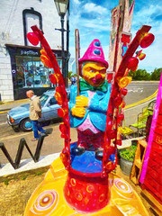 Whack Attack (Steve Taylor (Photography)) Tags: whackattack fairground clown cane hat margate pensioner sandals lights papillon butterfly art shop lamppost light chair colourful man uk gb england greatbritain unitedkingdom car automobile