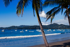 Potrero Bay (hey ~ it's me lea) Tags: costarica potrerobay palmtrees sailboats ocean sky tropical