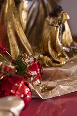 Decorating the Church 5 (amndcook - WAY behind on things) Tags: dof bokeh glitter church amandacook gold christmas red lights advent photograph macro photo decoration ornament green season spiritledphotography sparkle depthoffield pentax
