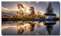 Morning Sun (jeremy willcocks) Tags: scotland calendoniancanal uk colour morning sun sunlight house boat trees water reflection clouds jeremywillcocks wwwsouthwestscenesmeuk fujixpro2 xf1024mm landscape
