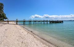 Maraetai Wharf (Andy.Gocher) Tags: maraetai wharf andygocher canon100d newzealand beachlands sky clouds water beach bluesky blue green
