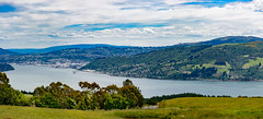 Dunedin Inlet Pano (Ron Scubadiver's Wild Life) Tags: stitched pano nikon new zealand south island landscape hills sky clouds water 70300