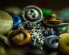Jewel in the Button Box (Dan Constien) Tags: macromonday macro buttonsandbows mondaydecember4thmacromonday sonya7 canon85mm18 hmm danconstien buttons bows silver owl