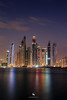 Dubai Marina (hisalman) Tags: dubai marina cayan tower building night clouds sky water reflection plalm plam jumeirah uae