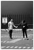 A tender goodbye! (cupitt1) Tags: boyfriend girlfriend girl boy lovers sweetheart farewell touching ship crew young fence black white monochrome xpro xpro1 fuji street photography contrast cruiseship princess golden tender tenderness love