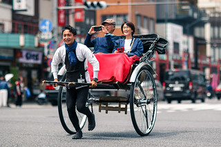 Japanese man pulling a carriage