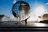 The Unisphere (Ben-ah) Tags: unisphere globe flushing queens newyork ny worldsfair 1964 flushingmeadow park peacethroughunderstanding peace symbol sky yoga acrobat split fountain water backlit silhouette