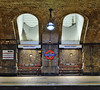 Sufficient Signage (Douguerreotype) Tags: bricks underground bench city station 2 uk sign arch metro british england tunnel gb architecture subway urban britain london light tube