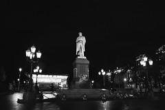 Evening. Monument to Alexander Pushkin (Andrey  B. Barhatov) Tags: moscow russia street silberrapan100 silberra panchromaticfilm bnwfilm panchromatic bnwmood blackandwhite noiretblanc blackandwhiteonly bnw geobw bwfp bw ru citywalks city citywalk outdoor outdoors travel monochrome monotone 2017 moscowwalks noir analog film filmtype135 filmfilmforever filmoriginal filmmood filmisnotdead filmphoto filmphotography lomography barhatovcom россия москва улицы город городскиезаметки пленка фотопленка чб чернобелое d76 grain evening night sculpture landscape cityscape urbanexploration lantern urbanlandscape pushkin пушкинскаяплощадь пушкин фонарь ночь вечер canoneos5 canon canonef28105 canonef2810513545usm slowshutter