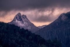 Mt Ida Sunrise (robertdownie) Tags: sky mountains clouds rock rocks snow dawn peak australia ominous rainforest wilderness tasmania crag highcountry nationalpark highlands travellersrange mtida cradlemountain lakestclair centralhighlands dolerite mountainscape sunrise crags craggy peaks