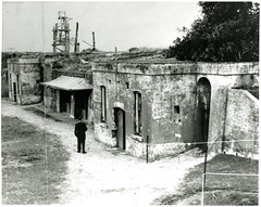 Black and White Photograph of Historic Buildings at Fort Lytton, Brisbane (Queensland State Archives) Tags: brisbane fortlytton military encampment queensland historicbuildings lytton person