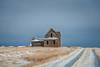 Chilly Lane (DeVaughnSquire) Tags: cold winter snow white homestead farmstead house abandoned wooden vintage past history prairie canada saskatchewan sky blue wood field stubble rural farm farmers