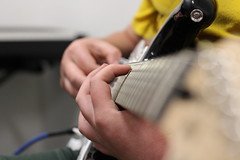 Teaching a Young Person to Play Guitar (LachMH) Tags: guitar squire fender black nifty fifty canon lens 50mm 700d t5i cube amplifier solo music metal rock finger hand instrument studio av audio