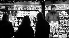 festive market at night 03 (byronv2) Tags: festive festivemarket christmasmarket peoplewatching candid street princesstreet princesstreetgardens edinburgh edimbourg edinburghbynight night nuit nacht blackandwhite blackwhite bw monochrome market mound shop shopping browsing