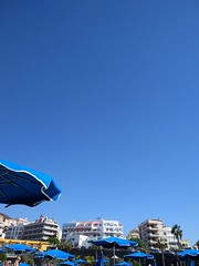 sky (curly_em) Tags: blue beach bluesky cloudless summer sunshine tenerife canaryislands loscristianos relax holiday vacation umbrella parasol buildings