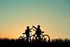 728871923 (evolutionlabs) Tags: modeoftransport togetherness bonding transportation wheel outdoors cycling landvehicle copyspace silhouette sunset sky people childhood bicycle mountainbike highfive 1011years girls 89years boys horizontalimage