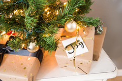 Christmas gifts under tree (yourbestdigs) Tags: christmas tree holidays green stringlights festive whitewall whitedresser gifts presents ornaments red joy holiday noel celebrate family tradition ribbon bow wrapped wrapping gifting artificial small miniature apartment interior home decor decoration