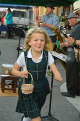 A hasty smile as she runs (radargeek) Tags: monterey ca california child farmersmarket market downtown 2017 march basket tongue running