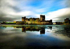 Caerphilly castle reflections (awardphotography73) Tags: longexposure landscape cadw history water cloud blueskies reflection reflecting castle caerphilly